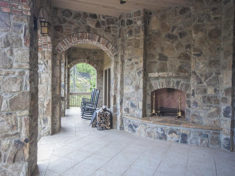 Lower porch with outdoor fireplace