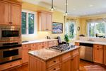 Bright, sunny gourmet kitchen is open to the nook and the family room.