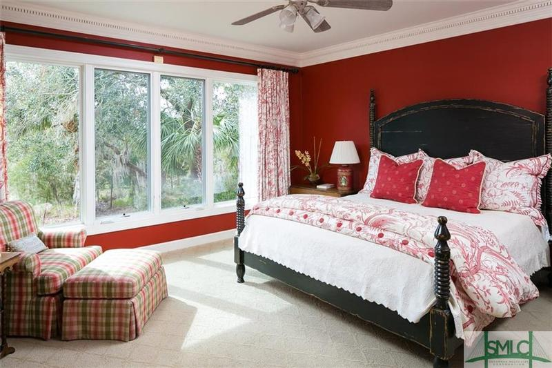 The lovely, peaceful Master Bedroom presents a relaxing sitting area and an amazing wall of windows.
