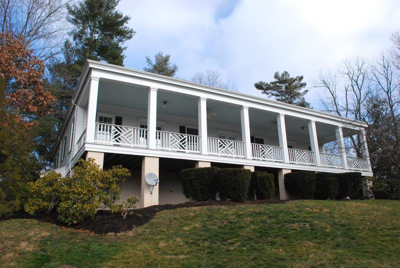 Expansive, covered porch at back of cottage