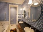 One of four classically appointed bathrooms