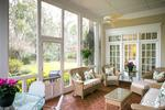 An English screened porch that looks out on your lushly landscaped estate sized lot.