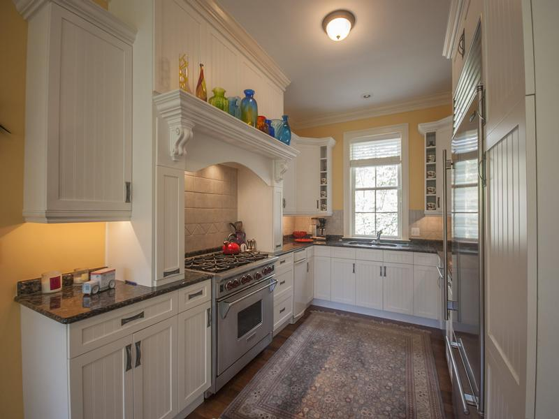 Gourmet kitchen adjacent to dining room and laundry