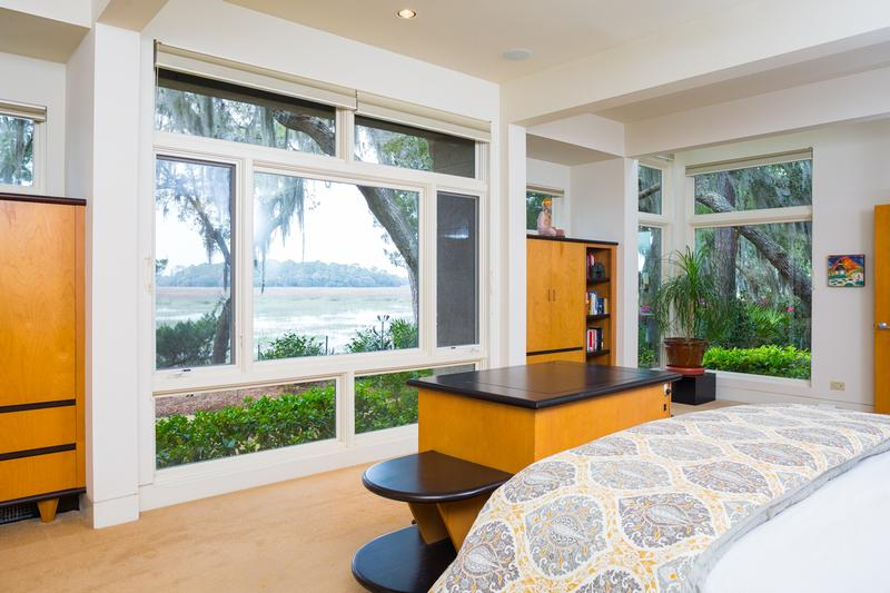 Magnificent master bedroom on main level overlooks breathtaking water and marsh views.
