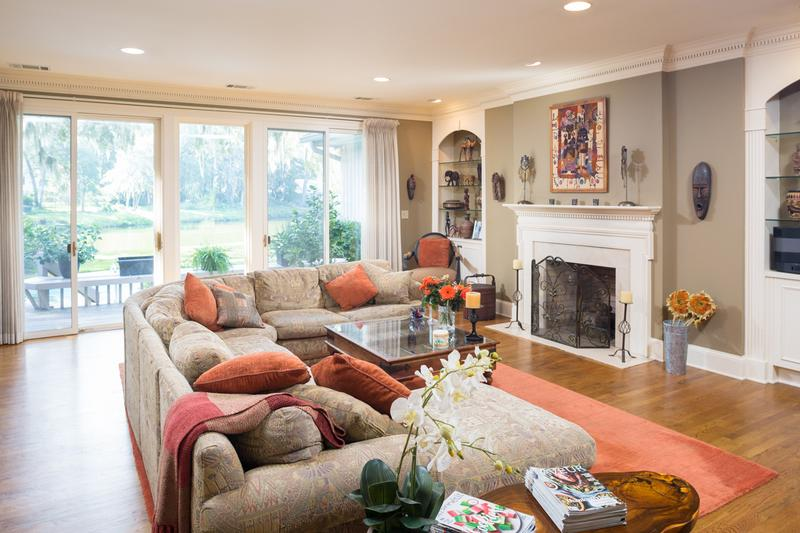 Relax by the fire in this gorgeous family room with Hardwood floors, stunning built in cabinetry, and cozy fireplace.