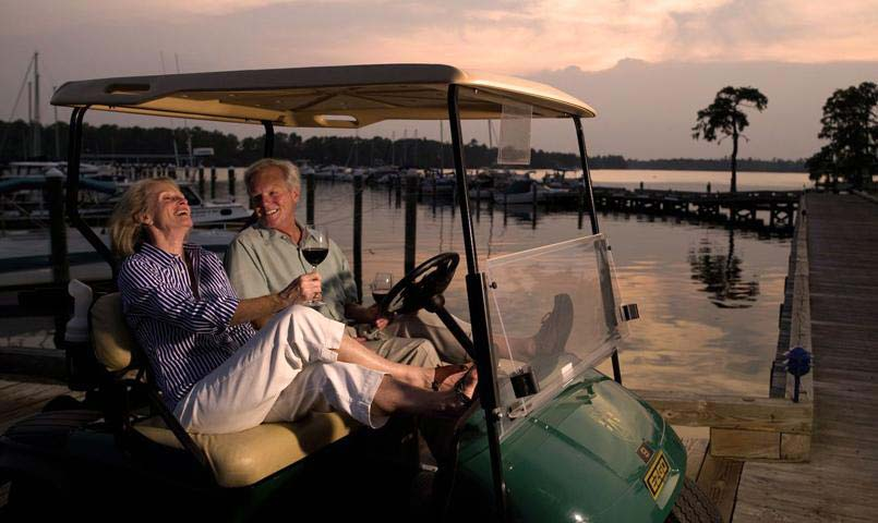 Couple in golf cart at Albemarle Plantation