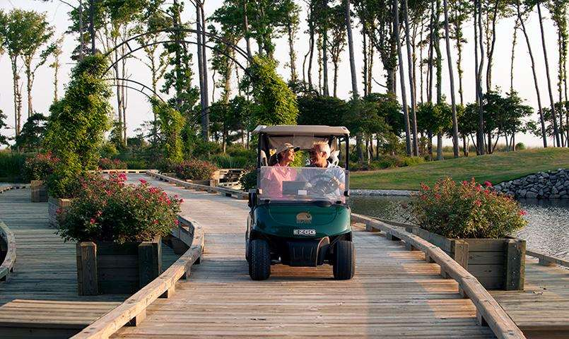 Couple in golf cart at Bay Creek
