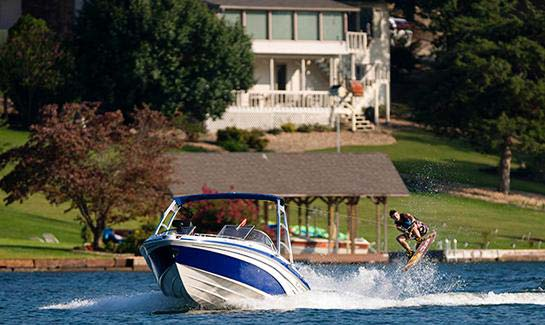 Boating and water sports are popular ways to spend the day on Bella Vista Village's lakes.