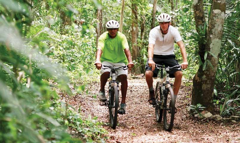 Men biking on trail at Bentsen Palm community in Mission, TX