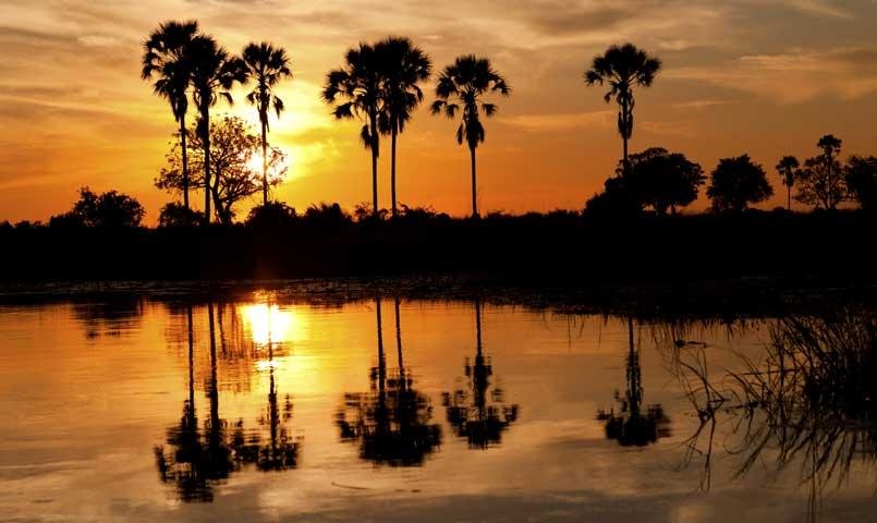 Sunset over lake at Bentsen Palm community in Mission, TX