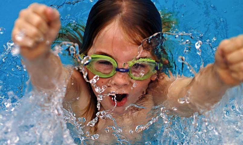 Child in swimming pool at Bentsen Palm community in Mission, TX