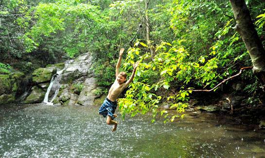 Try your hand on the rope swing at the Blue Hole in Blue Ridge Mountain Club