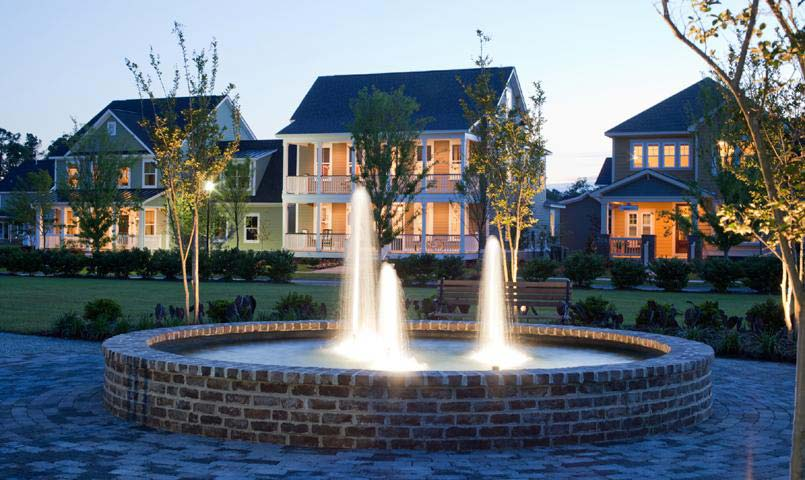Fountain in front of model homes at Carnes Crossroads at night