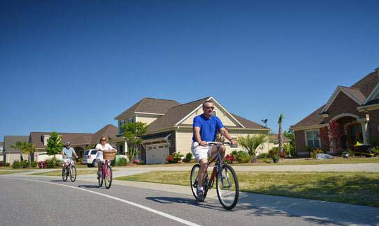 Residents walk, bike or hop on their golf cart to enjoy the resort-style amenities of Compass Pointe.