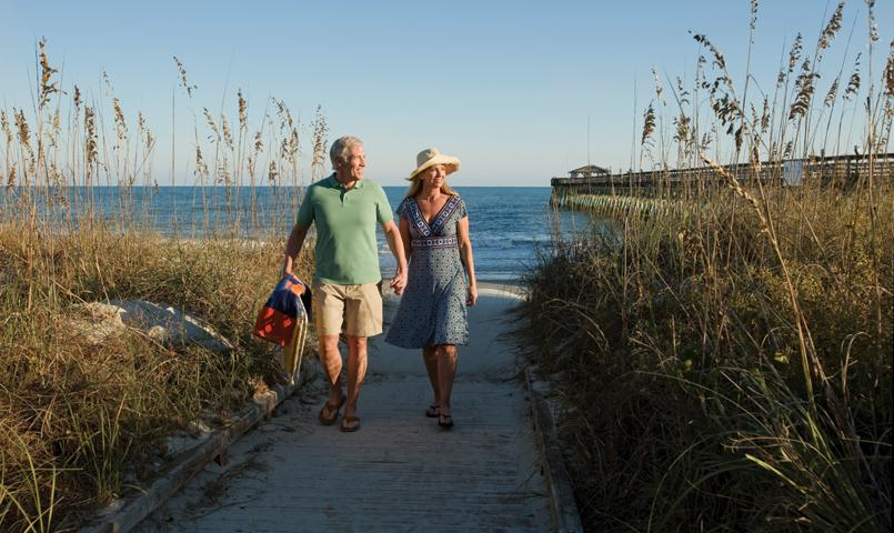 Couple walking on beach at Cresswind Myrtle Beach