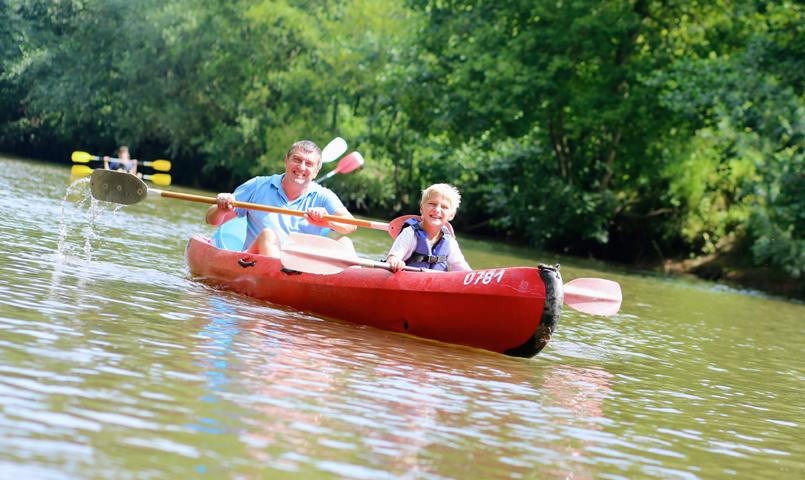 Father and son canoeing at Currahee Club