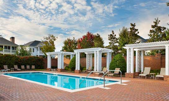 The Georgia Club offers a poolside Cabana Bar & Grille, children's play fountain and an adjacent playground.