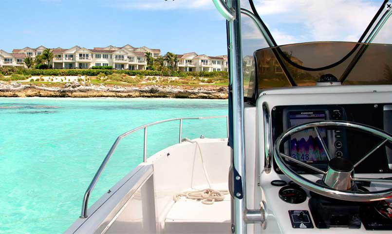 Boat in front of Grand Isle's Villas in Great Exuma, Bahamas