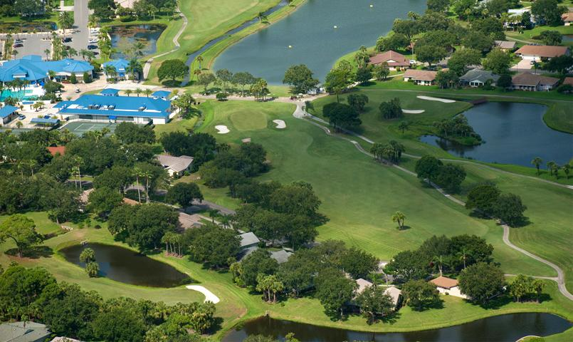 Many homes within Indian River Colony Club feature scenic golf course or lake views