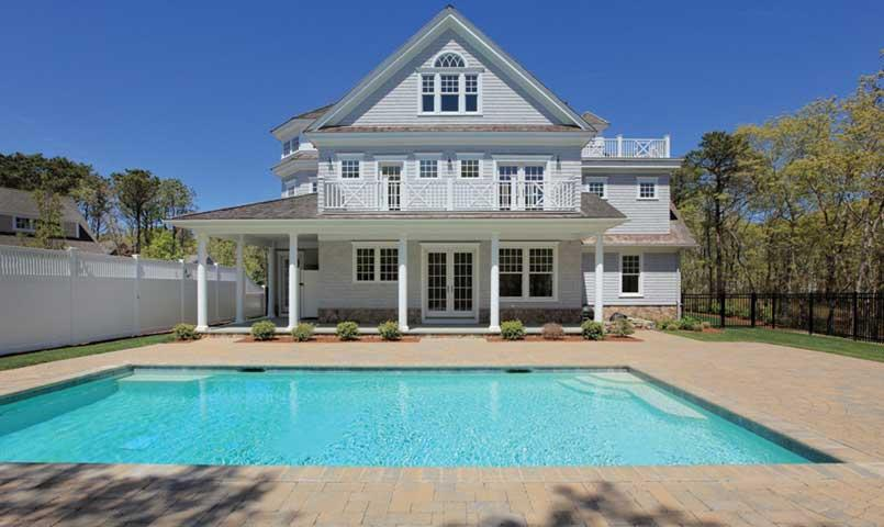Shingle-style home with swimming pool at New Seabury