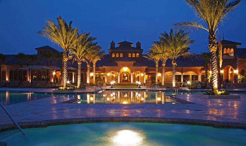 Nighttime view of the illuminated pool within Del Webb Ponte Vedra