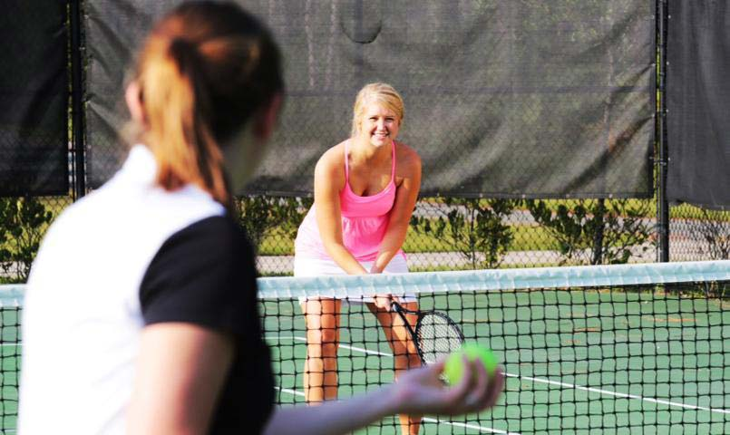 two women playing tennis