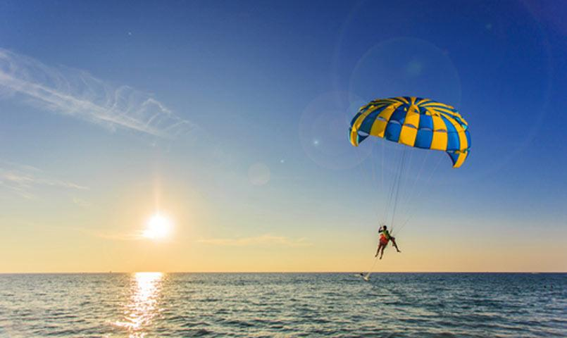 Couple parasailing at Palmetto Dunes