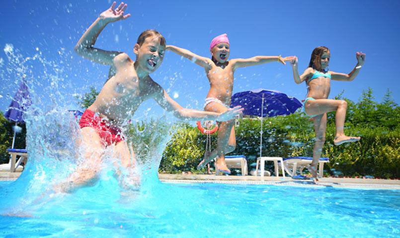 Children jumping into swimming pool at Palmetto Dunes