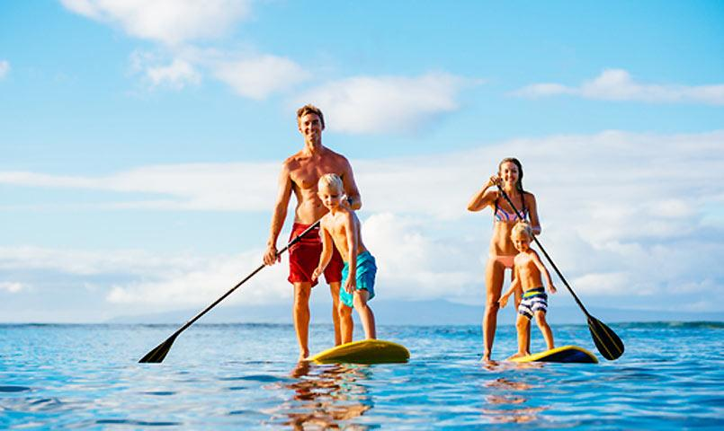 Family paddle boarding at Palmetto Dunes