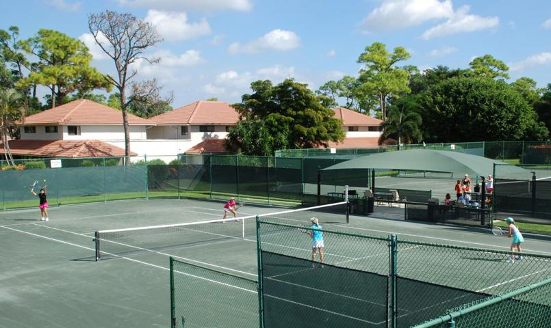 Set on three acres, Quail Ridge's expansive tennis facilities include a two-story tennis pavilion, 14 Har-Tru, 2 all weather and 4 lighted courts.