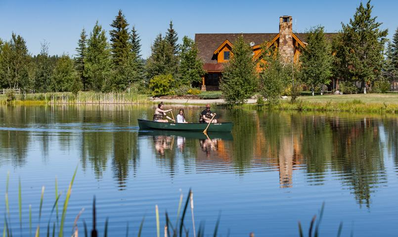 Family canoeing on lake in River Ranch McCall, Idaho