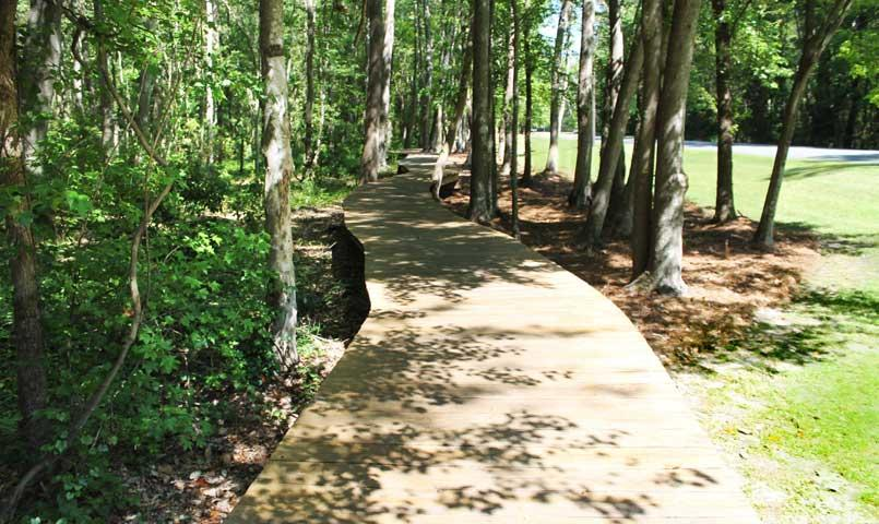 Miles of paved trails wind along shaded areas.