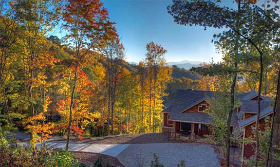 Custom residence amid fall foliage within Sunset Falls at Bald Creek