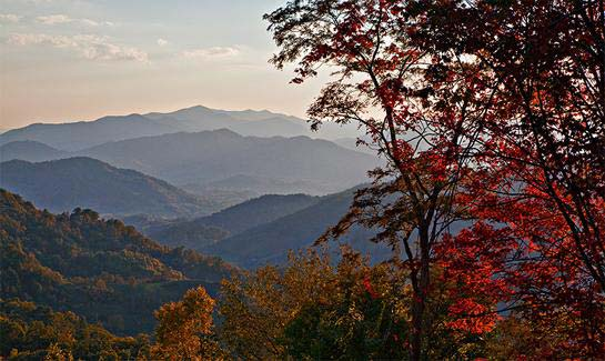 Autumn views of the layered Blue Ridge Mountains from Sunset Falls at Bald Creek