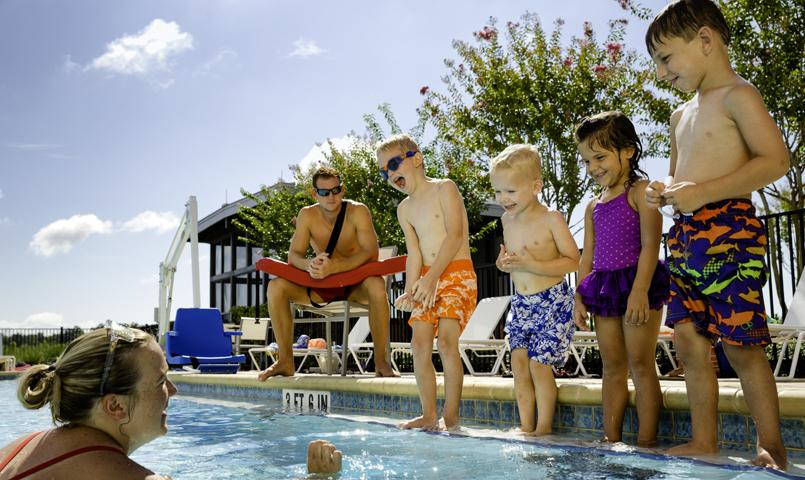 Waterset's community pool features a wading deck with sprayers and lap lanes enjoyed by kids and adults alike.