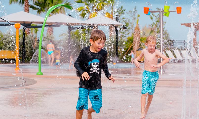 Residents enjoy the community splash park.