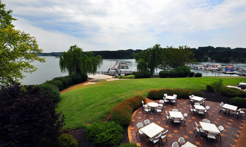 View of outdoor dining and lake at Tellico Village in Loudon, TN