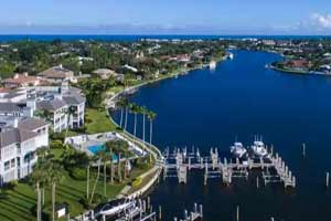 The Moorings in Vero Beach, Florida - This master-planned Treasure Coast community features an expansive private ocean beach, a Pete Dye golf course, a full-service marina and a clubhouse harboring a full complement of recreational amenities. Lots are priced from $995,000, with condos from $249,000 to $875,000 and single-family homes from $1 million to over $5.2 million.