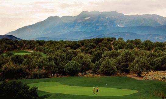 Couple on the Jack Nicklaus Signature Golf Course at Red Ledges