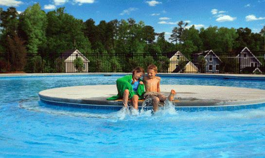 Briar Club's resort-style pool features two dual water slides, diving well, an eight-lane lap pool and a toddler splash pad.