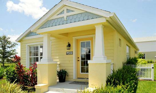 The affordably priced Rose Cottage features a welcoming front porch and rear entry garage.