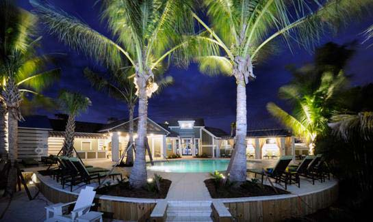 Evening view of the Beach Club at Harbour Isle on Anna Maria Sound features new coach model homes, designed in southern coastal resort-style architecture.