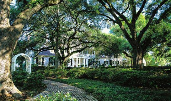 Beautiful gardens and centuries-old live oaks lead up to the riverside Inn at Brays Island Plantation.