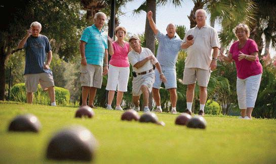 Residents enjoy an outside game of bocce ball at one of the many park areas.